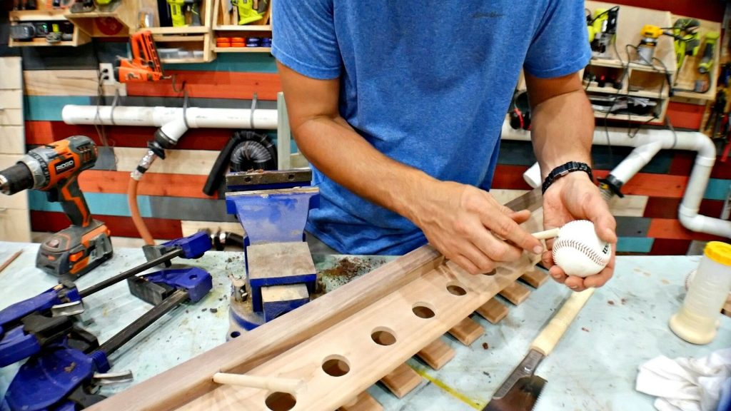 attach baseball to wooden dowel