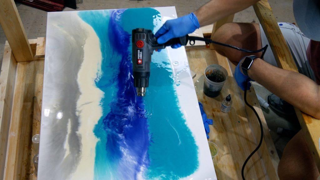 blend resin art on canvas with heat gun