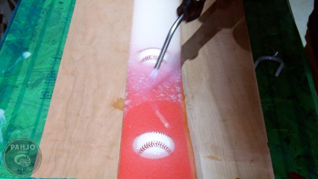 DIY Wood and Resin Wall Art - Baseball Storage Rack_Remove Bubbles
