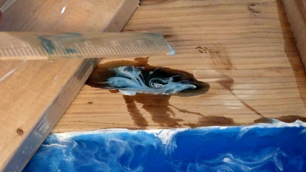 filling wood cracks with colored epoxy resin
