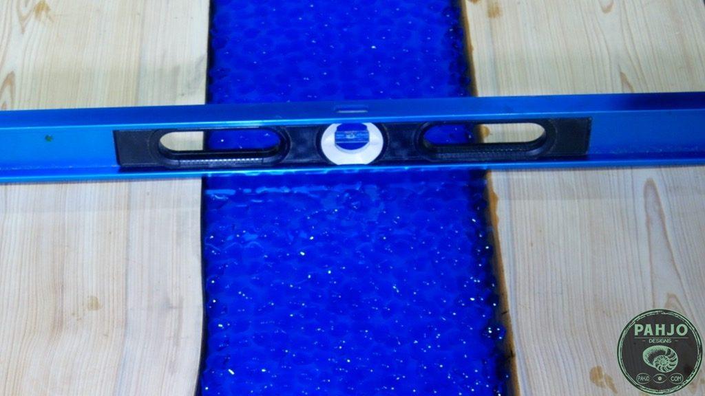 transparent epoxy river desk pour level check