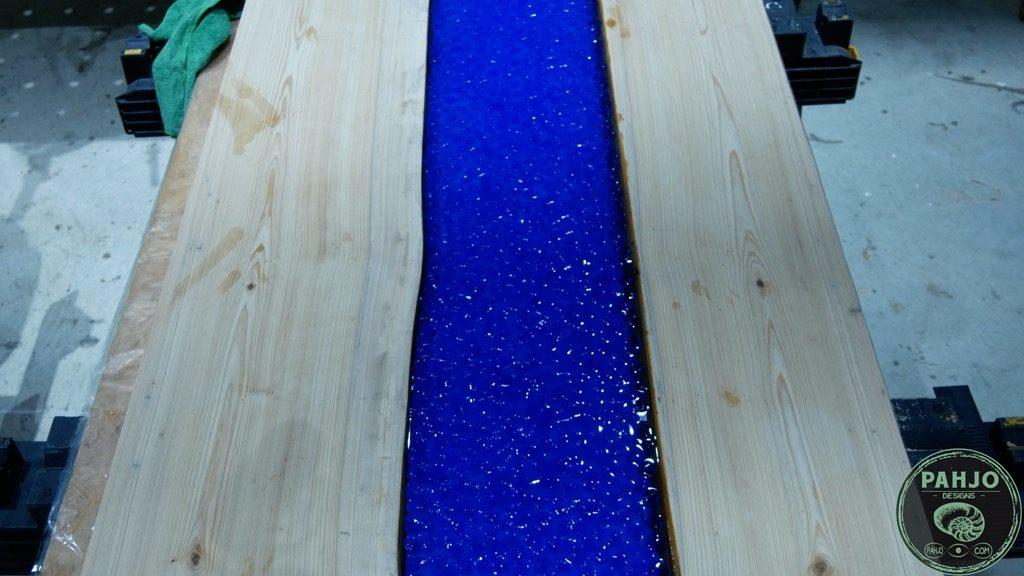 transparent epoxy river desk with rocks final pour