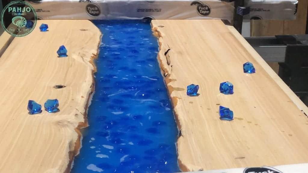 add acrylic rocks to epoxy river table