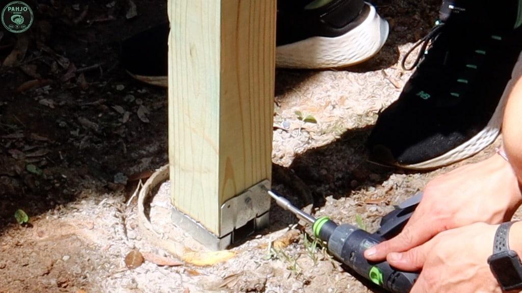 secure adjustable post base to concrete